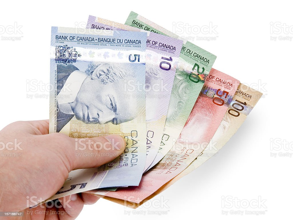 Canadian Currency in Hand (w/ clipping path) stock photo