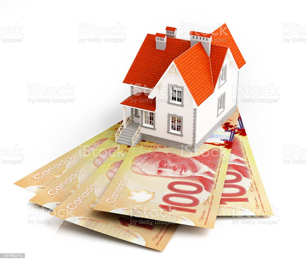 Canadian dollar banknotes under house stock photo