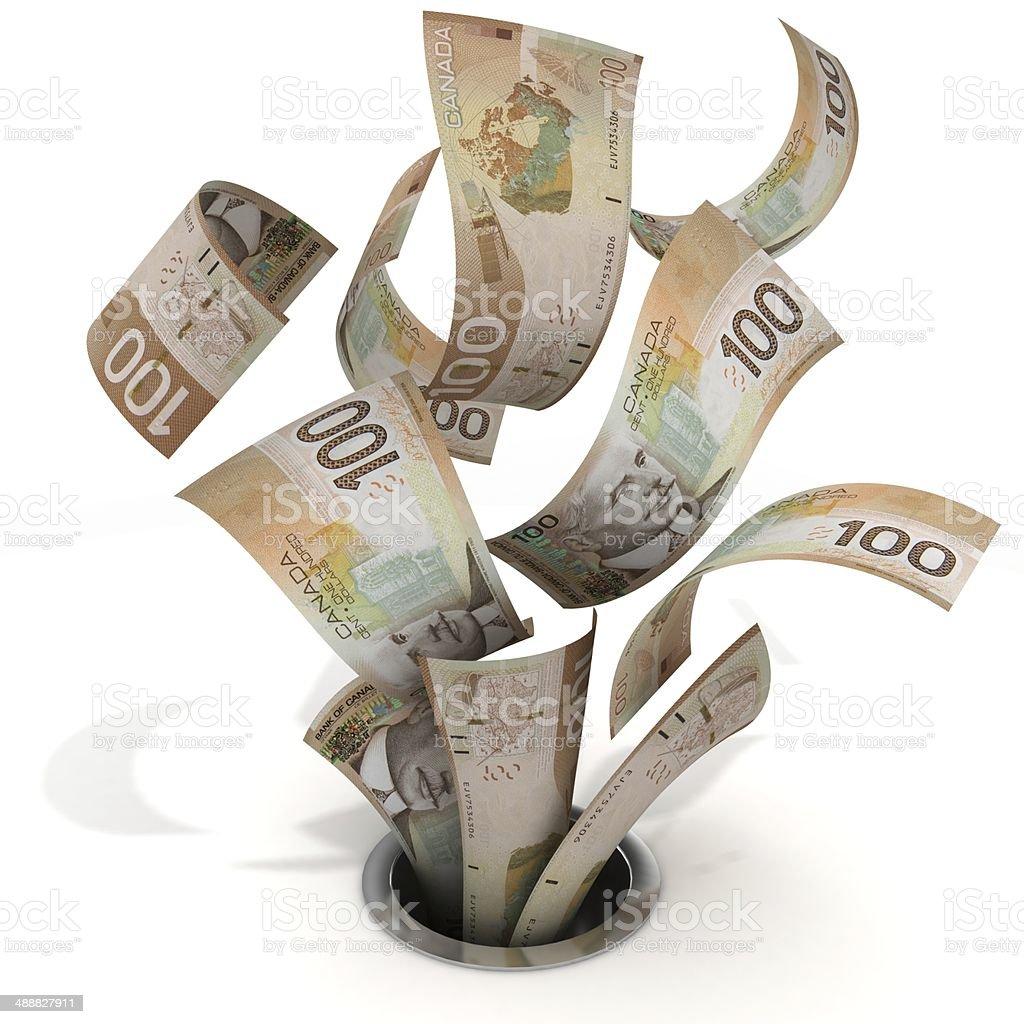 Canadian Dollars - Money Down the Drain stock photo