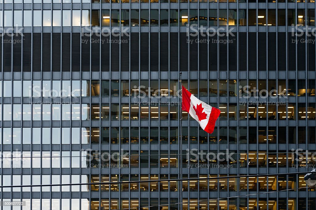 Canadian flag and modern office building in downtown Toronto stock photo