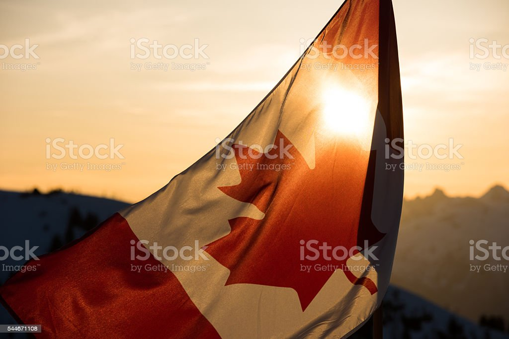 Canadian Flag at sunset stock photo