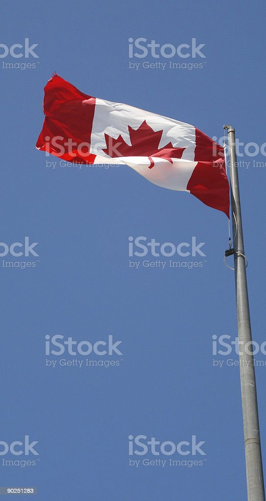 Canadian flag flies high royalty-free stock photo