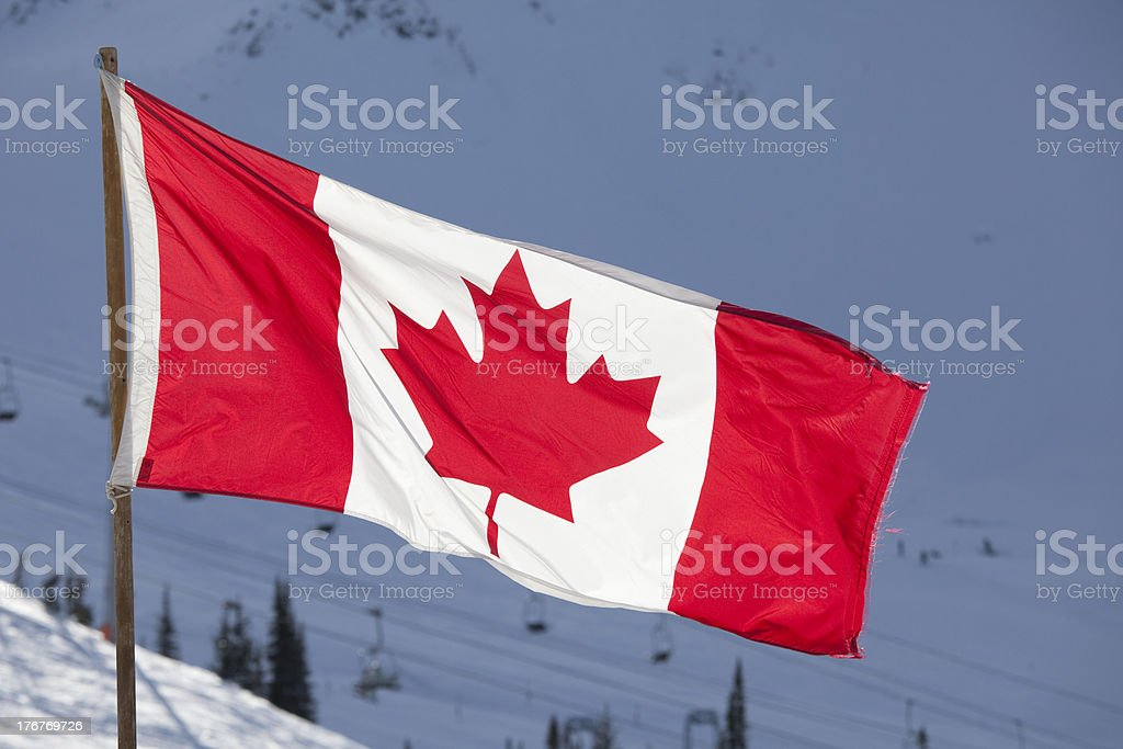Canadian flag flies in the mountains stock photo