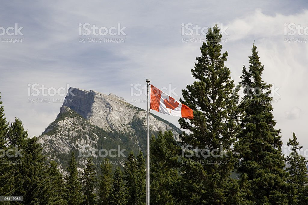 Canadian Flag in front of Mount Rundle (Rockies) stock photo