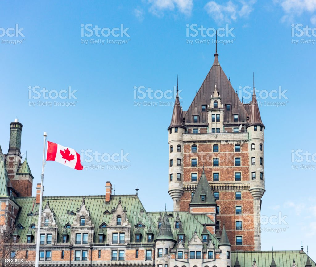 Canadian Flag in front of Quebec City's Château Frontenac stock photo
