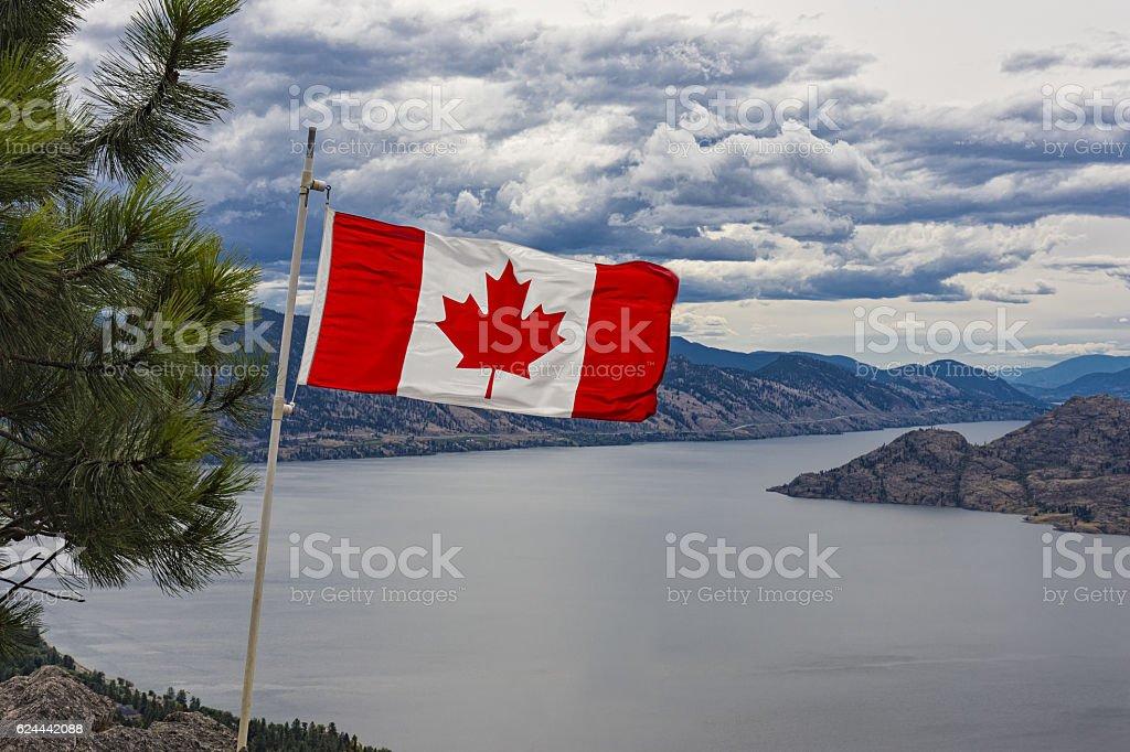Canadian Flag over Okanagan Lake near Peachland British Columbia Canada stock photo