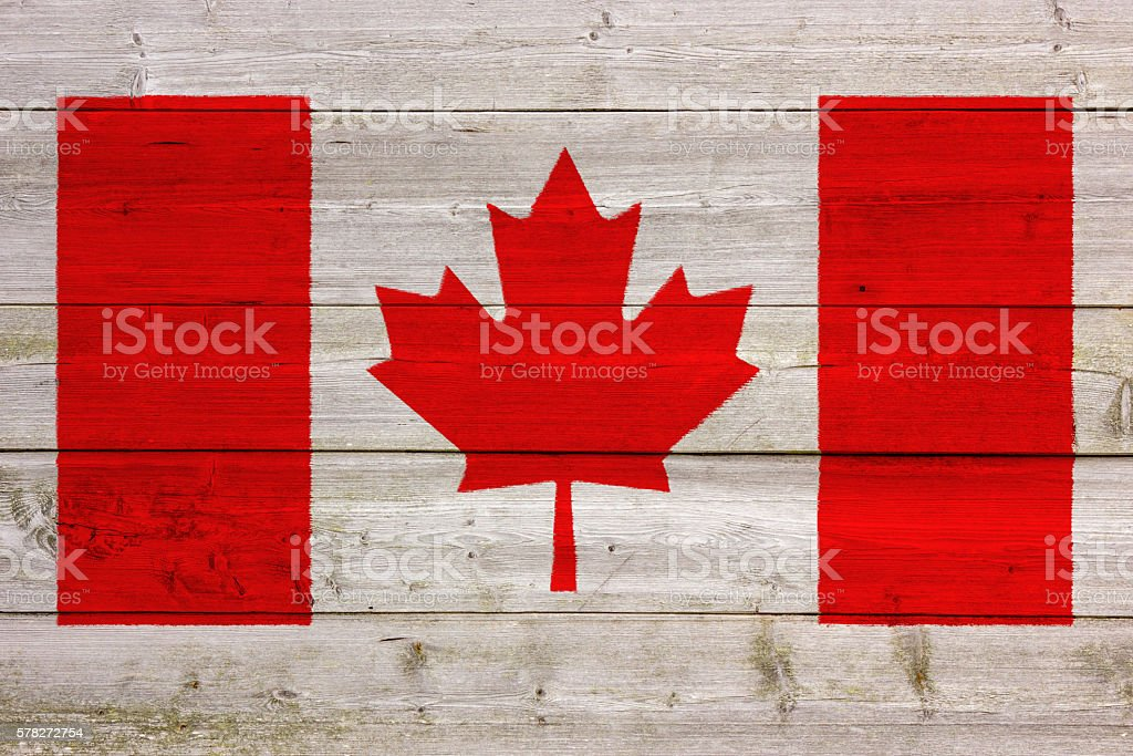 Canadian Flag Painted On Wooden Wall stock photo