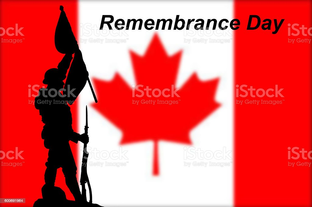 Canadian flag with silhouette of a soldier holding a flag stock photo
