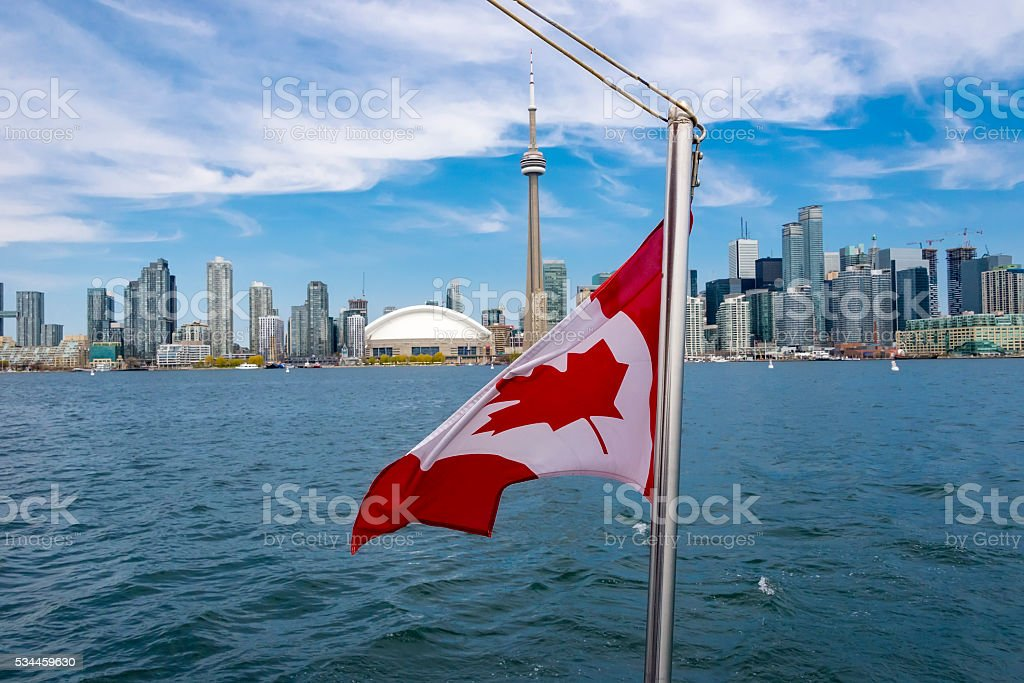 Canadian Flag with Toronto Skyline in Background stock photo