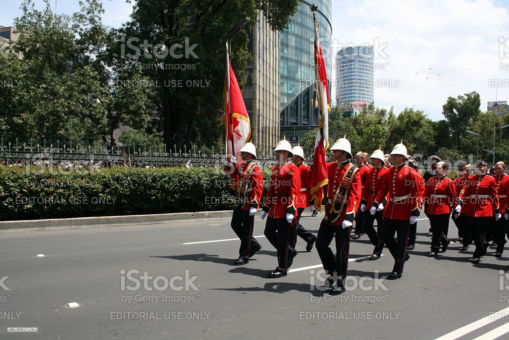 Canadian military marching in the Bicentennial aniversary of Mexico's Independence. stock photo