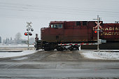 Canadian Pacific locomtive at a crossing