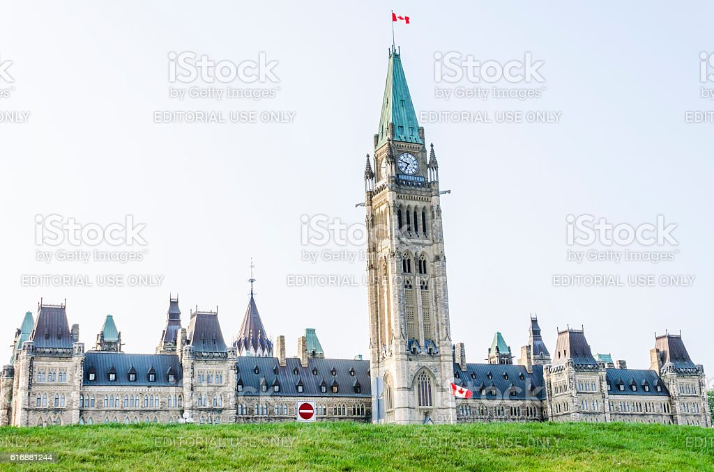 Canadian parliament hill building with flags stock photo