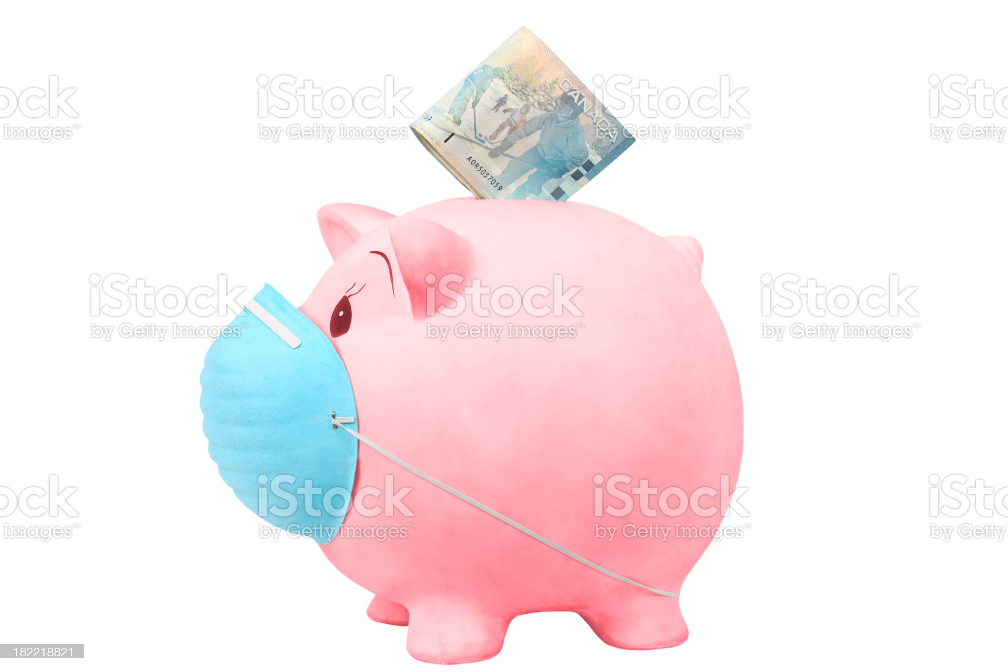 Canadian Piggy Bank with medical mask royalty-free stock photo