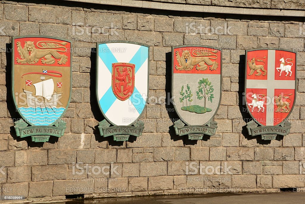Canadian provincial coats of arms on a stone wall. stock photo