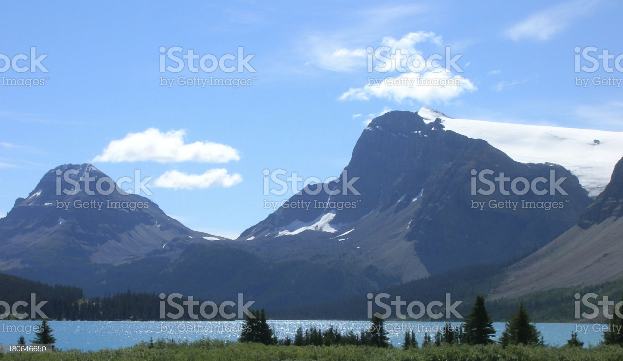 Canadian Rockies, grass foreground, lake, then mountains with gl royalty-free stock photo