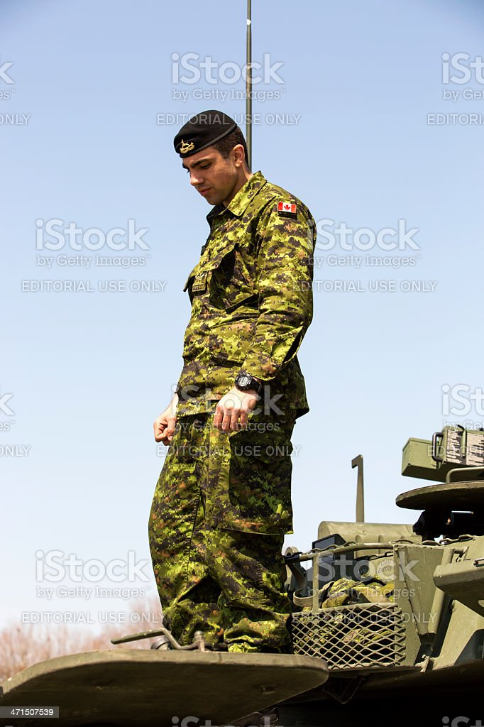 Canadian Soldier on Armoured Vehicle stock photo