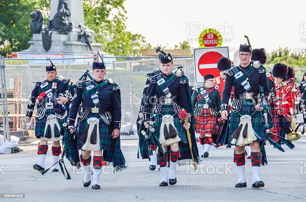 Canadian Soldiers with kilts walking during parade next to parliament stock photo