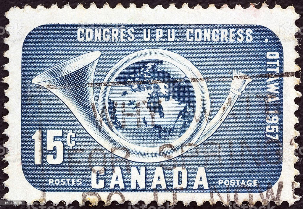 Canadian stamp shows Globe within posthorn (1957) royalty-free stock photo