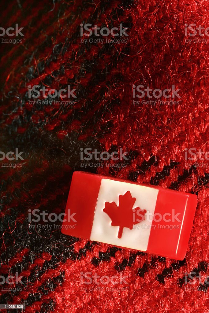 Canadian Stick Pin On Red Woolen Plaid Material royalty-free stock photo