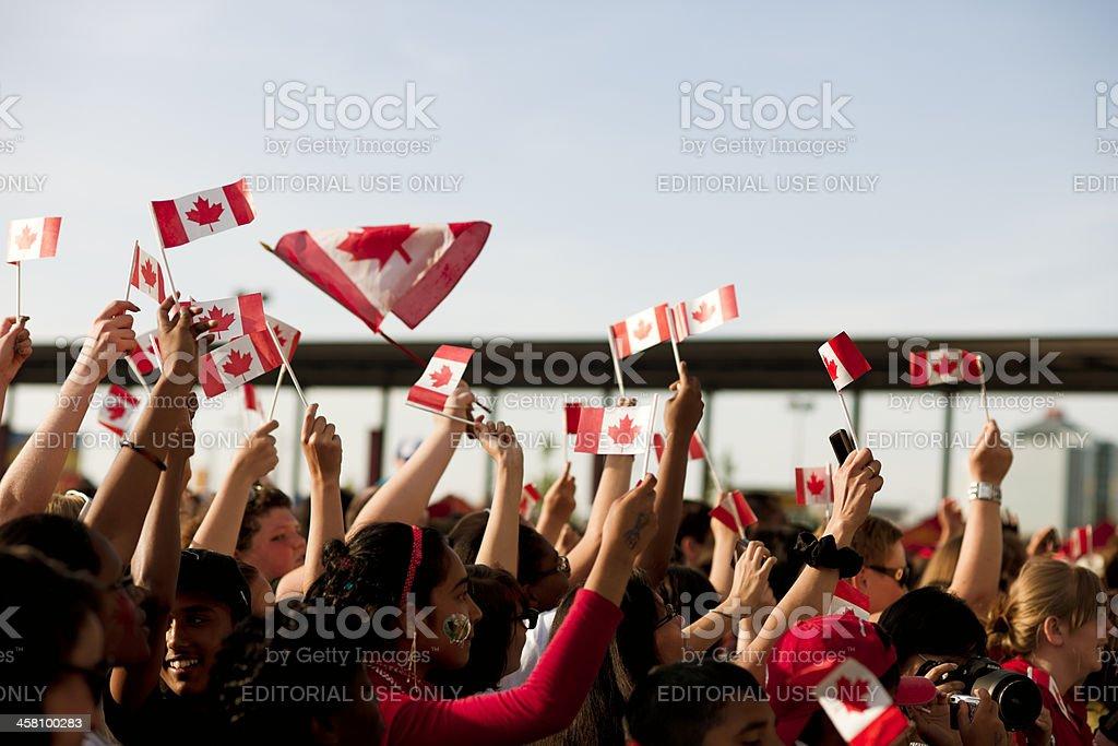 Canadians Waving Flags, Patriotism stock photo