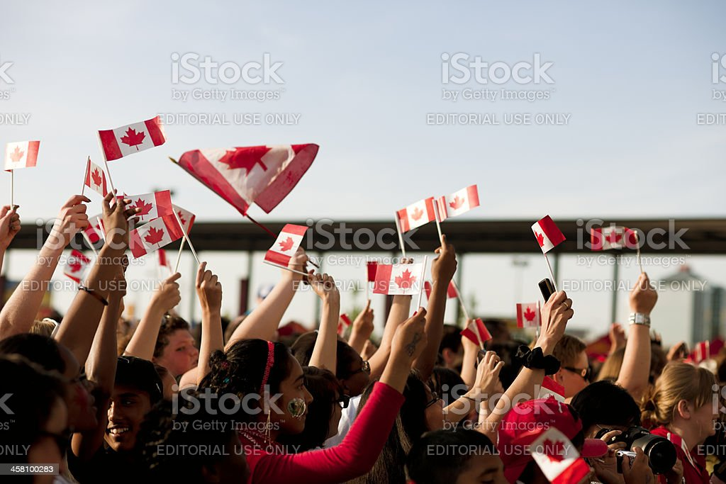 Canadians Waving Flags, Patriotism stock photo