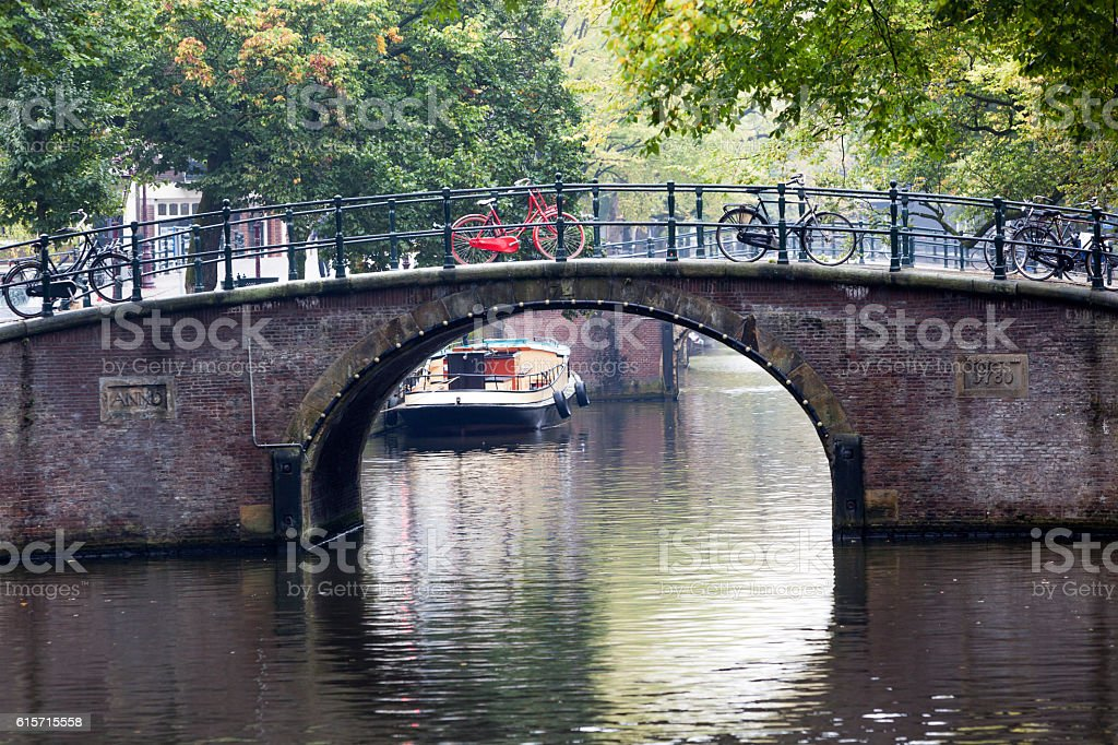 Canal and bridge in Amsterdam stock photo
