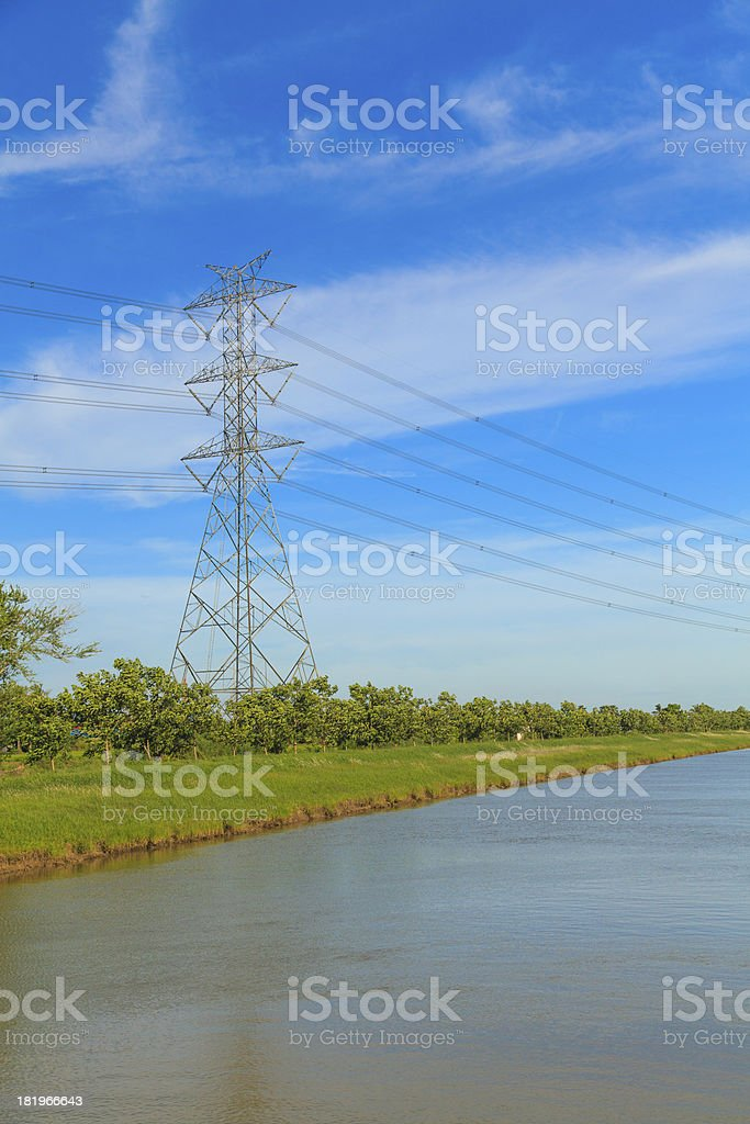 Canal and high voltage poles royalty-free stock photo