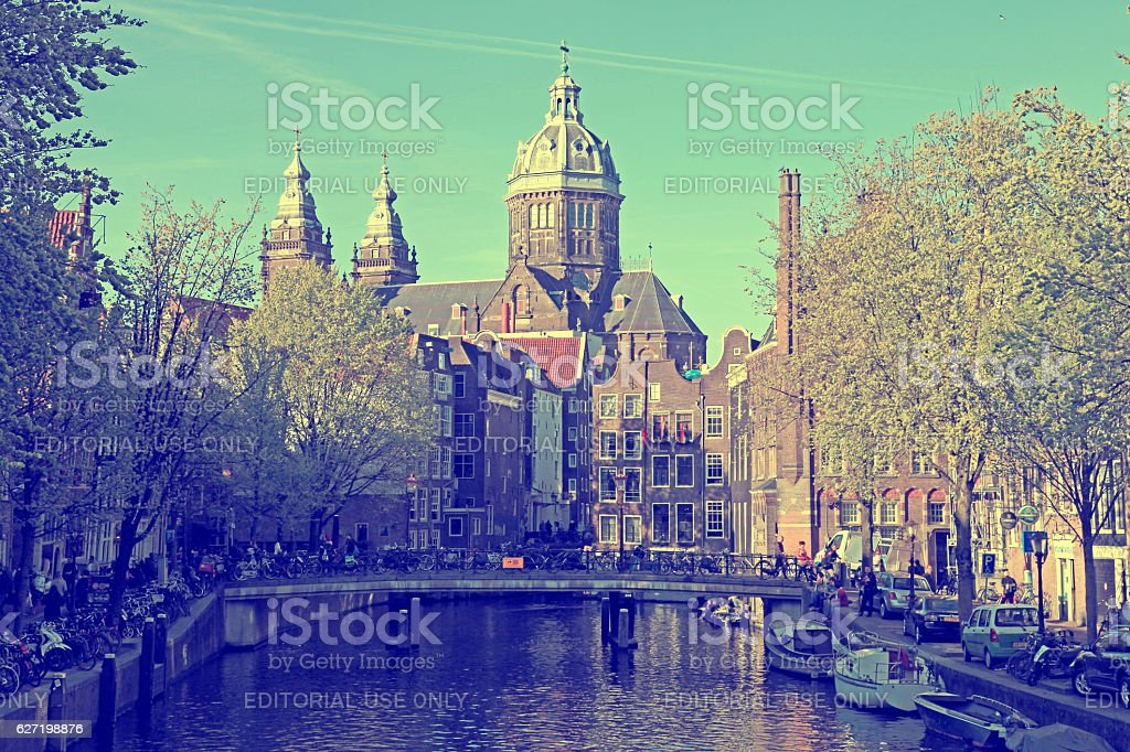 Canal and St. Nicolas Church in Amsterdam, the Netherlands Canal stock photo
