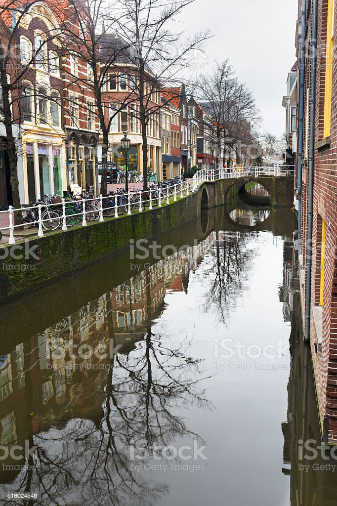 Canal and street with bicycle parking lot in Dutch Delft stock photo