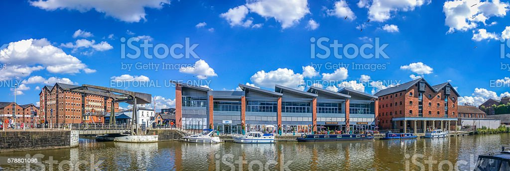 Canal barges motor boats moored at warehouse development Gloucester Docks stock photo