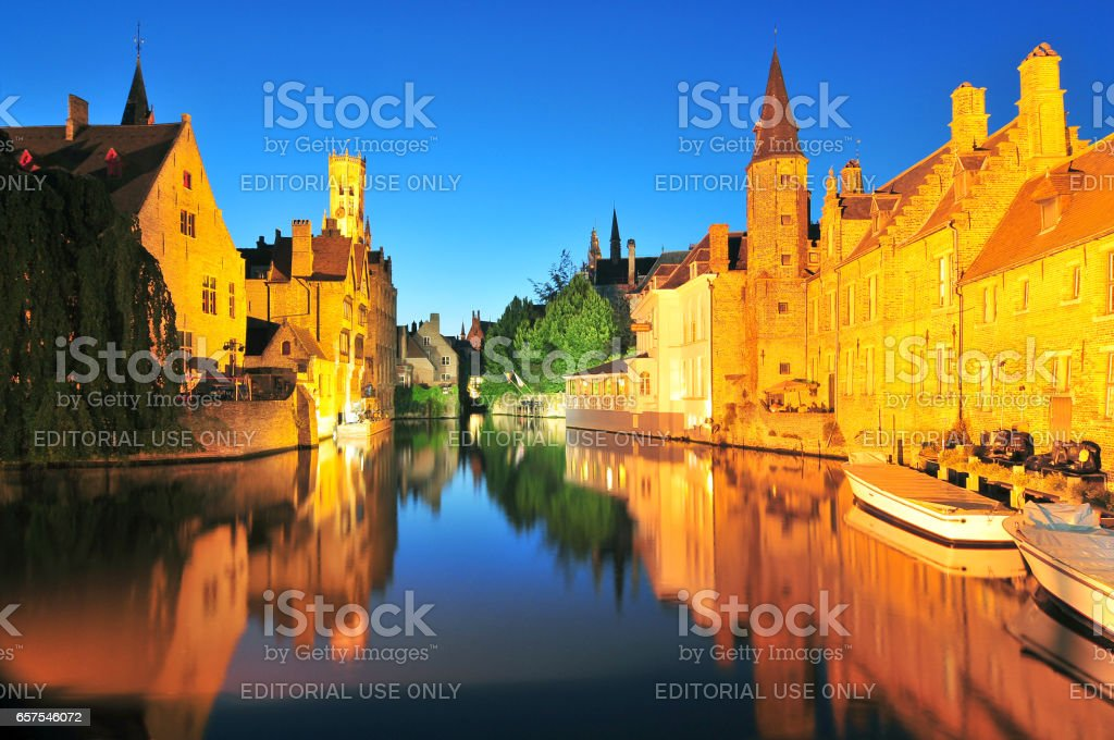 Canal belfry and houses at Bruges. stock photo