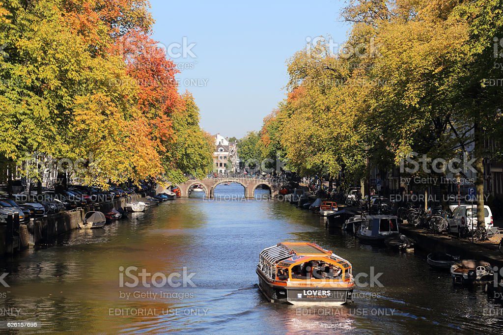 Canal boat in autumn in Amsterdam, Holland stock photo