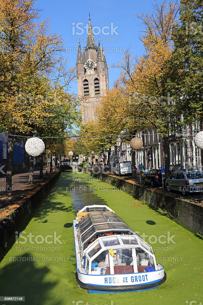Canal boat in autumn in Delft, Holland stock photo