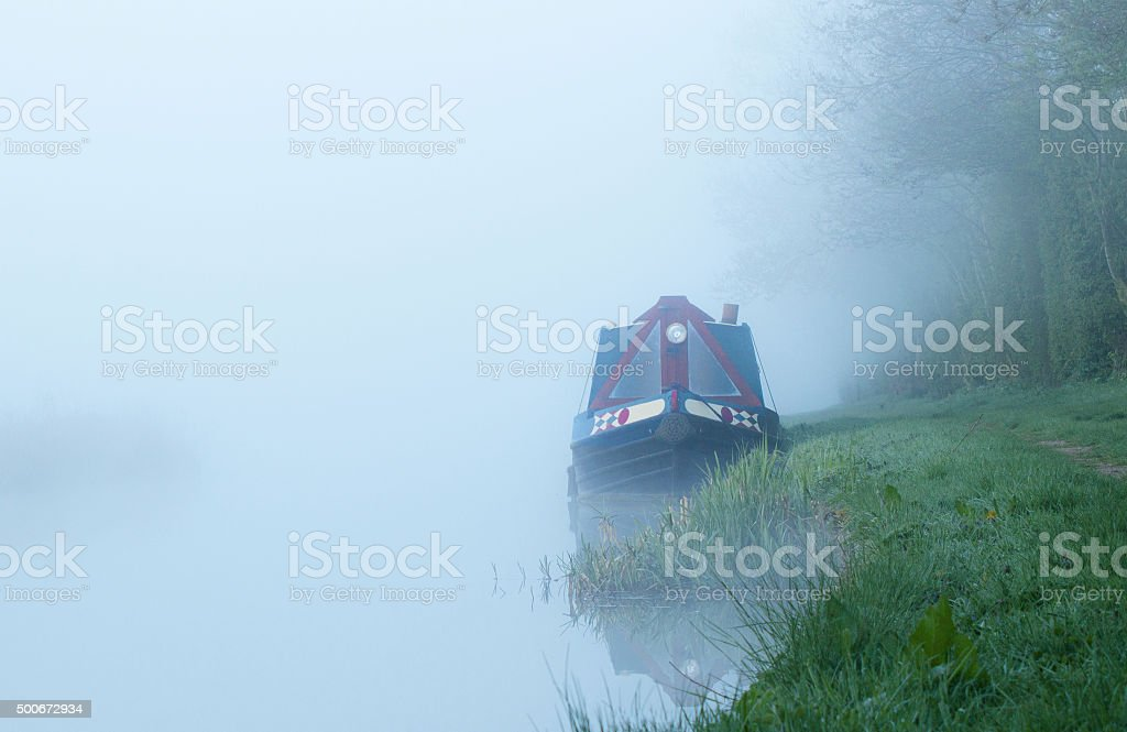 Canal boat in fog stock photo