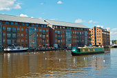Canal boat passes through Gloucester Docks
