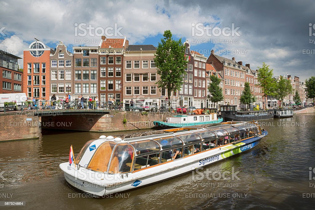 Canal Boat Tour in Amsterdam, Netherlands stock photo