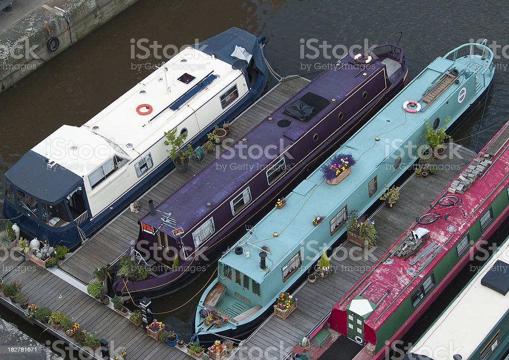 Canal boats from above moored at Gloucester Docks stock photo