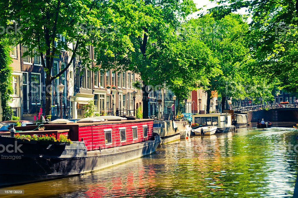 Canal boats in Amsterdam stock photo