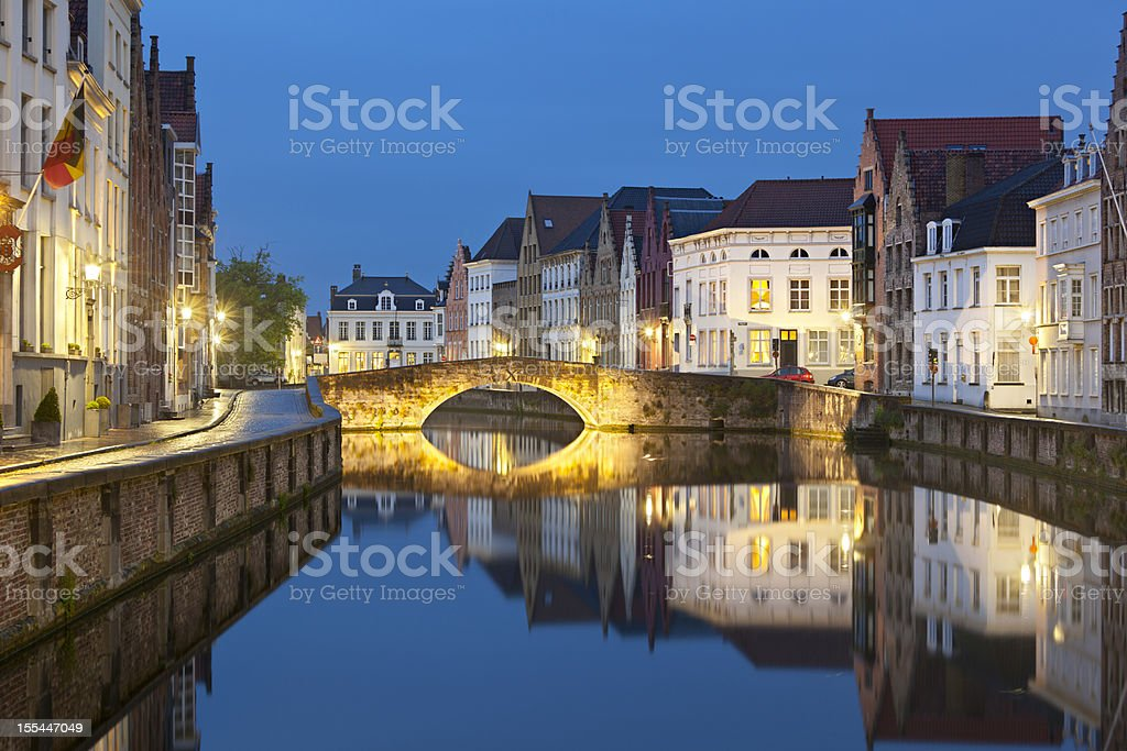 Canal Bridge In Bruges At Night stock photo