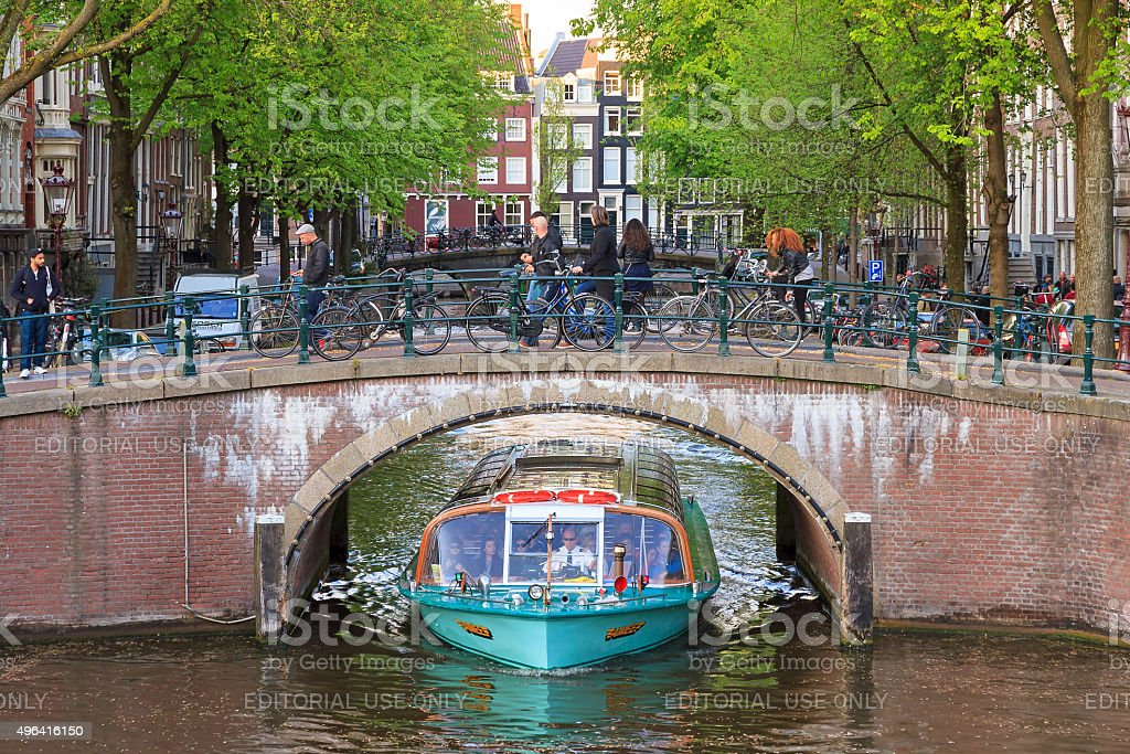 Canal cruise boat bridge stock photo