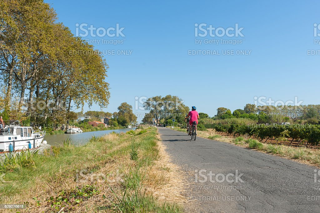 Canal Du Midi, and walking and cycling path  outside Villeneuve stock photo