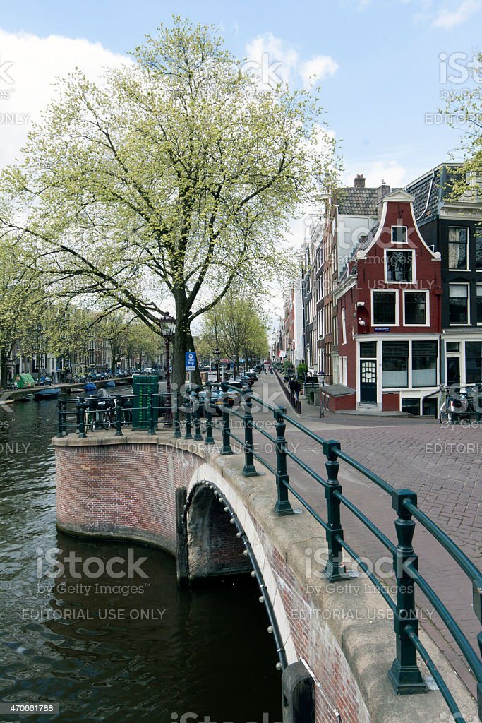 canal in amsterdam with bridge, prinsengracht, reguliersgracht stock photo