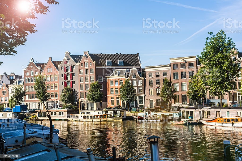 Canal in Amsterdam with sun stock photo