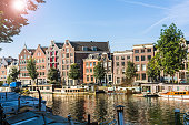 Canal in Amsterdam with sun