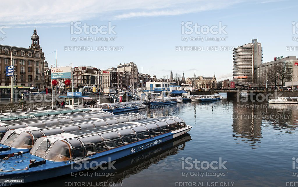 Canal in front of central train station, Amsterdam stock photo