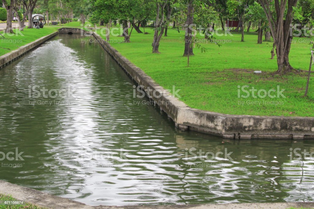 Canal in Park beautiful and reflect  the shadow in the water. stock photo