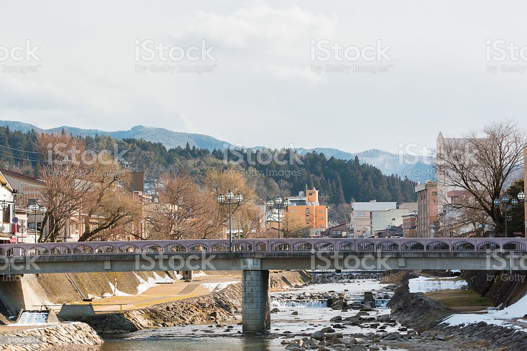 Canal in Takayama old town with empty bridge. stock photo