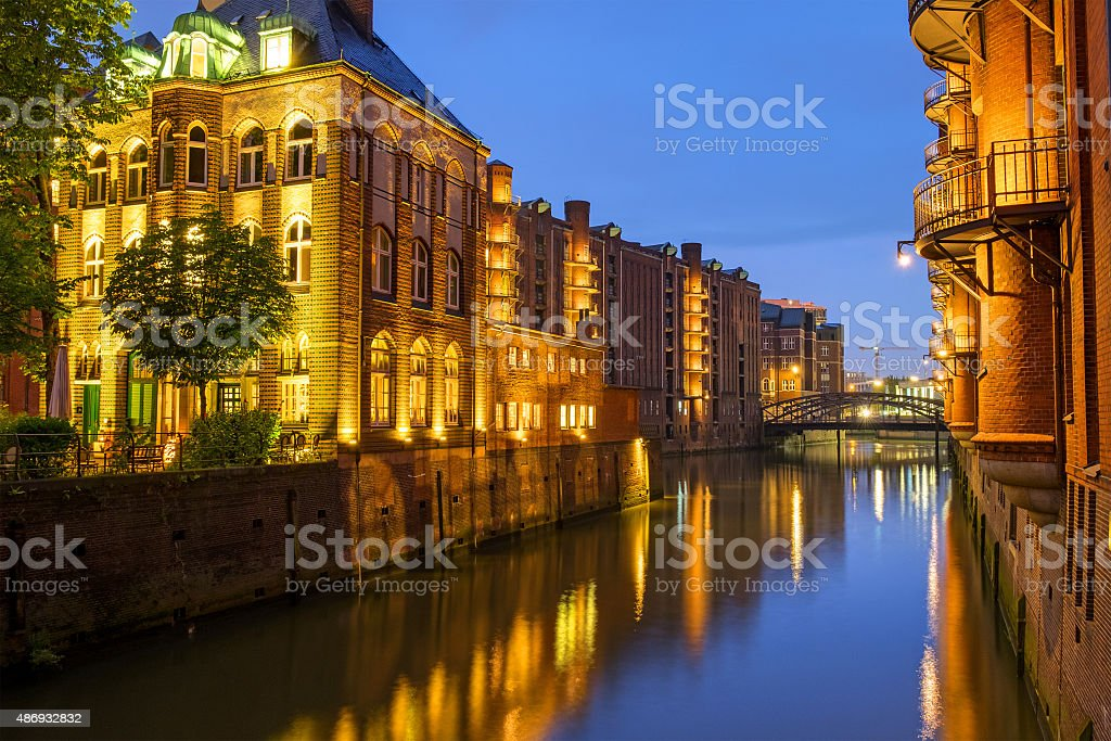 Canal in the Speicherstadt at night stock photo