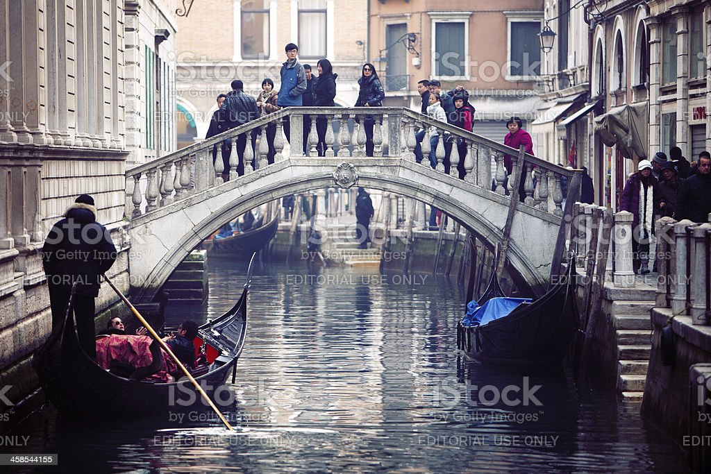 Canal in Venice, Italy, with many tourists royalty-free stock photo