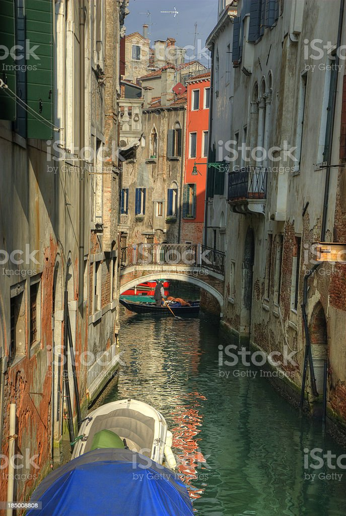 Canal in Venice with gondola royalty-free stock photo